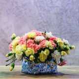 Carnation bouquet on wooden table Royalty Free Stock Photography