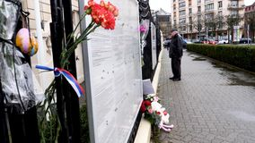 Carnation flower with Russian Flag band at Russian Consulate Embassy mourning victims fire at Zimnyaya Vishnya. STRASBOURG, FRANCE - MAR 28, 2018: Carnation stock footage