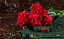 Carnation flowers on marble and uniform with a star as background by May 9. Red carnation flowers on marble and uniform with a star as background by May 9 Stock Illustration