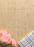 Carnation and gift on the linen pattern Stock Image