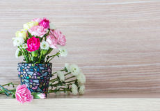 Carnation in mosaic flower pot Stock Photos
