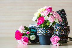 Carnation in mosaic flower pot Stock Image