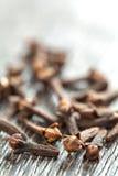 Carnation spice on dark wooden background Stock Photos