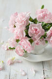 Carnation in vase. Roses and carnation in vase on wooden backgrouund stock photos