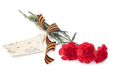 Carnations with George ribbon and old letters Royalty Free Stock Image