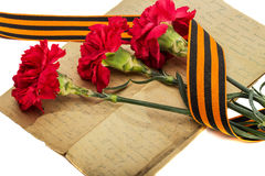 Carnations, old letter, and St. George Ribbon Royalty Free Stock Photos