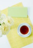 Carnations and tea Stock Photography