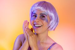 Carnaval Brazil. Portrait of latin woman wearing purple wig and makeup mask. Color background. Masquerade concept, celebration and. Carnaval Brazil. Excited and stock photography