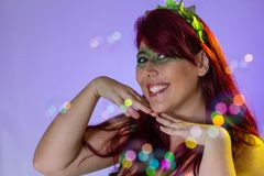 Carnaval Brazil. Face of brazilian red hair girl wearing green makeup mask. Bright background. Masquerade concept, celebration and. Carnaval Brazil. Hands and stock photography