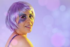 Carnaval Brazil. Face of brazilian woman with violet wig and make up mask. Color background. Masquerade concept, celebration and. Carnaval Brazil. Happiness and royalty free stock photos