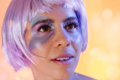 Carnaval Brazil. Face of brazilian woman with violet wig and make up mask. Color background. Masquerade concept, celebration and. Carnaval Brazil. Surprised and royalty free stock photos