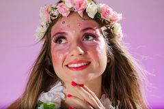 Carnaval Brazil. Portrait of brazilian woman with bright makeup. Colorful background. Carnival concept, fun and party royalty free stock photo
