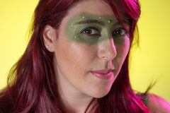 Carnaval Brazil. Portrait of latin redheaded woman and green makeup mask. Colorful background. Carnival concept, fun and party. Carnaval Brazil. Happiness and stock image