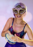 Carnaval Brazil Tambourine. Portrait of latin girl with violet wig and make up mask. Color background. Masquerade concept,. Carnaval Brazil Tambourine. Happiness stock photos