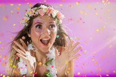 Carnaval Brazil.Throwing confetti. Colorful background. Carnival concept, fun and party. Face of young woman with colorful makeup. Carnaval Brazil. Surprised and stock image