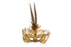 Carnaval Mask. Brown carnaval mask made with feathers isolated on black stock photo