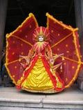 Carnaval: máscara en rojo y amarillo Imagen de archivo