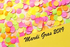 Carnaval party background concept. Space for text, copyspace. Mardi Gras 2019. Colorful confetti. Carnival party background concept, space for text. Written the stock image