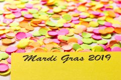 Carnaval party background concept. Space for text, copyspace. Mardi Gras 2019. Colorful confetti spread over table. Carnival party background concept, space for stock images