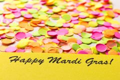 Carnaval party background concept. Space for text, copyspace. words: Happy Mardi Gras! Colorful confetti. Carnival party background concept, space for text royalty free stock photo