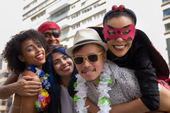 Carnaval party. Dressed Brazil people going to street Carnival. Happy brazilian partygoers in costume celebrating in parade. Carnaval party. Dressed crowd of stock images