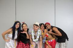 Carnaval party. Dressed Brazil people going to street Carnival. Happy brazilian partygoers in costume having fun in parade royalty free stock images