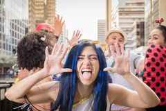 Carnaval party. Group of Brazil friends in the city Carnival. Brazilian woman in costume having fun in parade festival stock photography