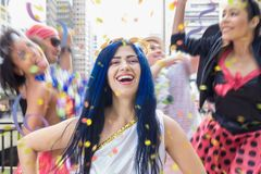 Carnaval party. Group of Brazil people in the city Carnival. Brazilian woman having fun in parade festival royalty free stock photography