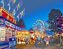 Carnaval situado a mitad del camino en el crepúsculo Fotografía de archivo libre de regalías
