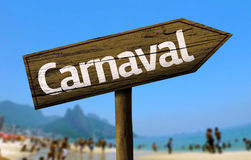 Carnaval wooden sign on the beach Royalty Free Stock Images