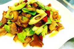 Carne & alho-porro da fritada da agitação do estilo de Szechuan do chinês Foto de Stock
