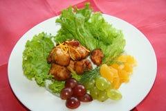 Carne arrostita con l'uva Immagini Stock