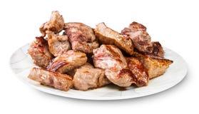 Carne arrostita su un piatto bianco Immagini Stock