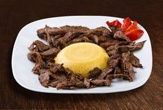Carne asada con polenta Fotografía de archivo