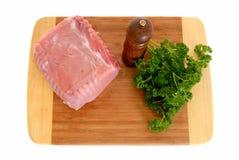 Carne asada de cerdo del filete en la tarjeta de corte Fotos de archivo