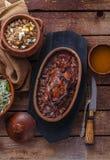 Carne asada de Hazel Grouse con las gachas de avena del buckweat y la salsa de arándano fotos de archivo