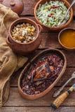 Carne asada de Hazel Grouse con las gachas de avena del buckweat y la salsa de arándano imagen de archivo