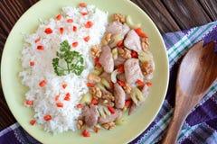 Carne asada del pollo con apio del tallo, nueces asadas y arroz Fotografía de archivo libre de regalías