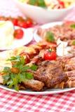 Carne asada a la parilla en la placa Fotografía de archivo