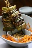Carne asiática del estilo y pincho vegetal imagenes de archivo