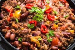carne chili przeciwko Tradycyjny Meksykański jedzenie Obrazy Royalty Free