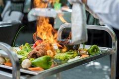 Carne com fogo Foto de Stock