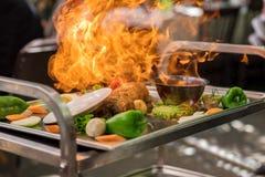 Carne com fogo Fotos de Stock