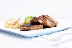 Carne com molho Fotografia de Stock Royalty Free