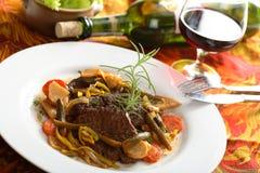Carne com vinho Fotografia de Stock Royalty Free