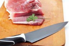 Carne con el cuchillo Imagenes de archivo