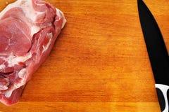Carne con el cuchillo Imágenes de archivo libres de regalías