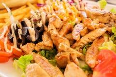 Carne con il contorno Fotografia Stock