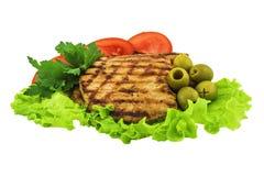 Carne cotta con le verdure Isolato su priorità bassa bianca Fotografia Stock