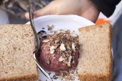 Carne crua com trufas e pão Fotos de Stock Royalty Free
